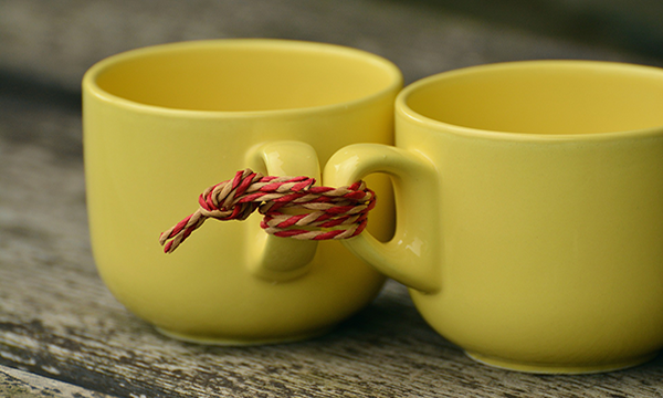 Two cups tied together