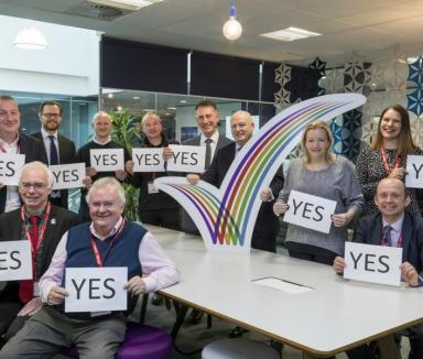 group of people voting to yes to extend the Manor Royal Business Improvement District (BID)
